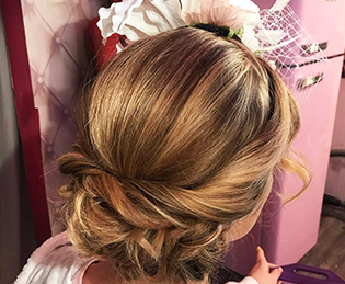 Bridal trends – Hair by Kelly – a loose bun twisted style