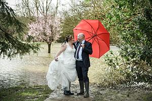 Jodie & Richard on their wedding day dancing in the flood water at Ironbridge Hotel