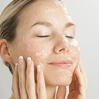 Women using beauty products on face
