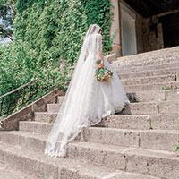 Bride walking up stairs