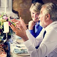 dementia-wedding-Including wedding guests with dementia in your big day - two mature guests chat at the table