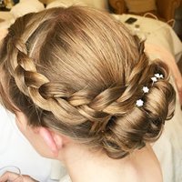 Bridal trends – Hair by Kelly – a plaited bun with white flowers