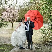 Jodie & Richard on their wedding day dancing in the flood water at Ironbridge Hotel
