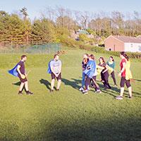 Men playing qudditch on a stag do