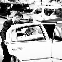 man helping bride out of limosine