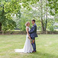 Married couple stood in the grounds Woodhall Spa