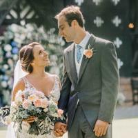 Couple getting married at historic hall
