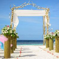 Wedding on beach next to the blue sea