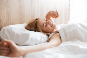 Women stretching after a good nights sleep